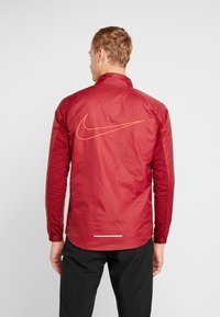Nike Performance - TRACK AIR - Chaqueta de deporte - team red/scream green/bright crimson