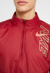 Nike Performance - TRACK AIR - Chaqueta de deporte - team red/scream green/bright crimson - 5