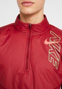Nike Performance - TRACK AIR - Chaqueta de deporte - team red/scream green/bright crimson - 5