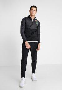 Nike Performance - TRACK AIR - Sports jacket - black/scream green/bright crimson - 1