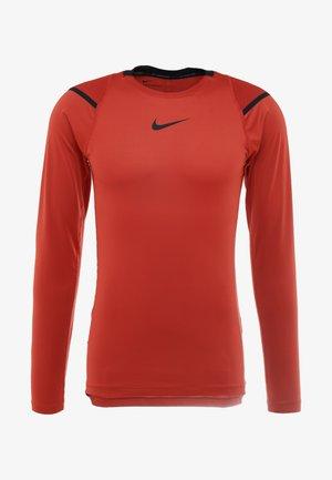 AEROADPT - Long sleeved top - dune red