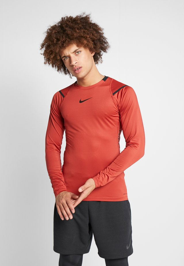 AEROADPT - Langærmede T-shirts - dune red