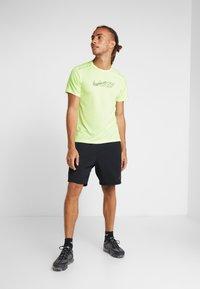 Nike Performance - MILER FLASH - Print T-shirt - barely volt/silver - 1