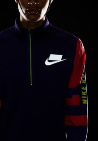 Nike Performance - WILD RUN MIDLAYER - Camiseta de deporte - court purple/kumquat/reflective silver - 6