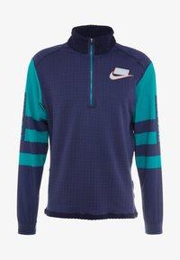 Nike Performance - WILD RUN MIDLAYER - Sports shirt - blackened blue/reflective silver - 6