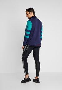Nike Performance - WILD RUN MIDLAYER - Sports shirt - blackened blue/reflective silver - 2