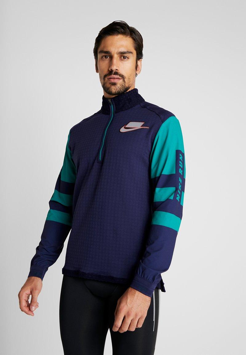 Nike Performance - WILD RUN MIDLAYER - Sports shirt - blackened blue/reflective silver