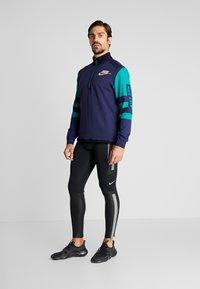 Nike Performance - WILD RUN MIDLAYER - Sports shirt - blackened blue/reflective silver - 1
