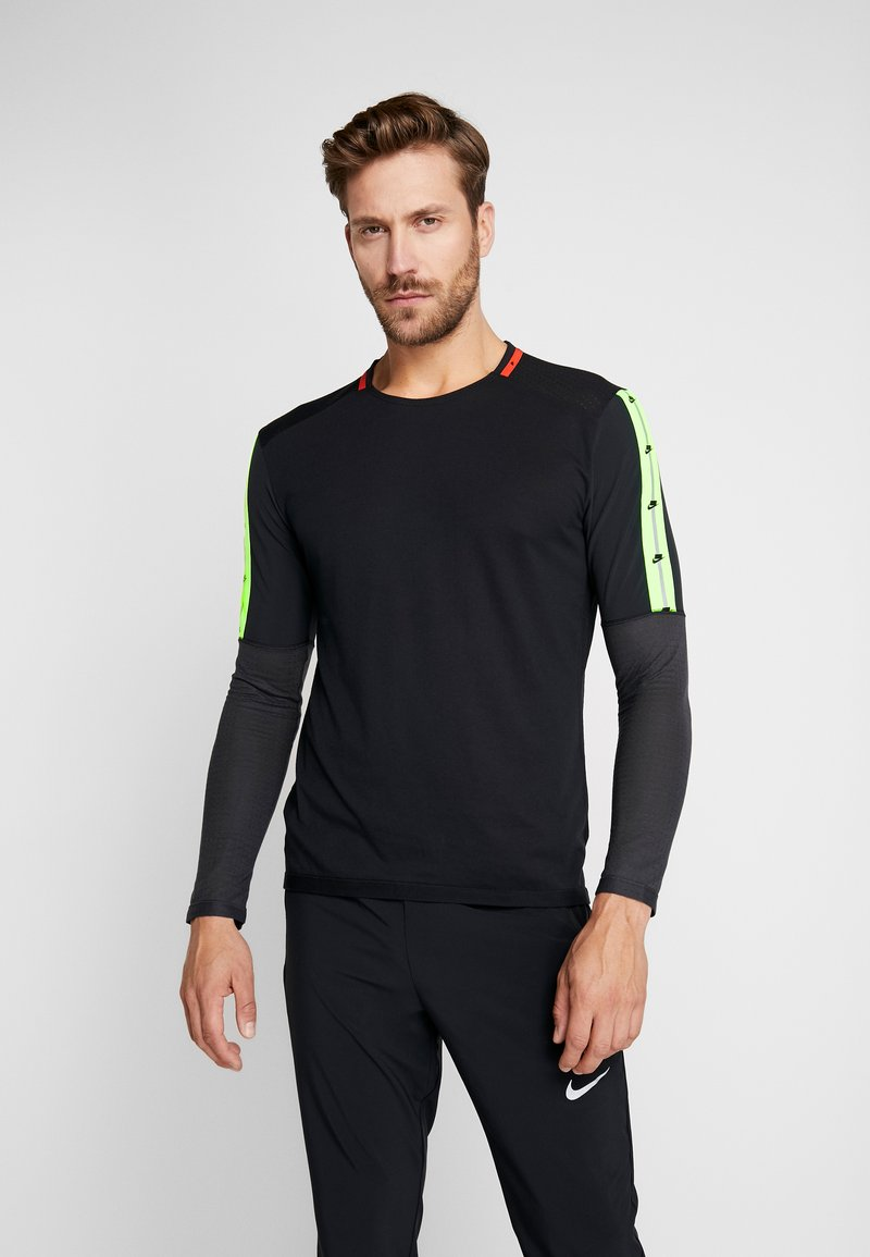 Nike Performance - WILD RUN - Sports shirt - black/off noir