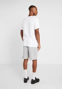 Nike Performance - DRY TEE NIKE TRAIN - T-Shirt print - white/black - 2