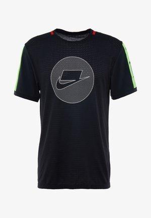 WILD RUN - Sportshirt - black/electric green/pale ivory
