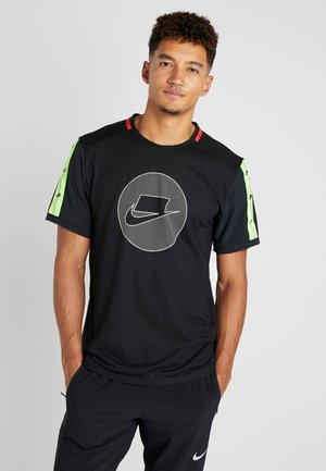 WILD RUN - Sports shirt - black/electric green/pale ivory