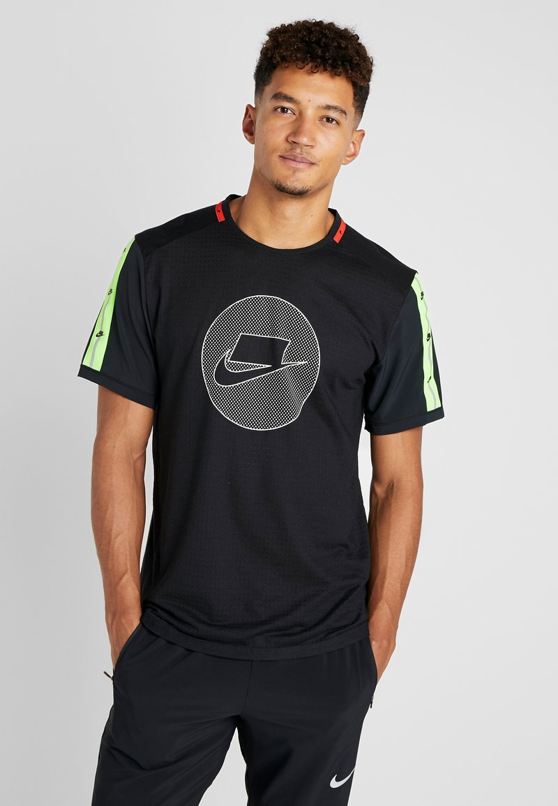 Nike Performance - WILD RUN - Sports shirt - black/electric green/pale ivory