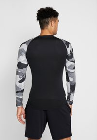 Nike Performance - SLIM CAMO  - Sports shirt - black/white - 2