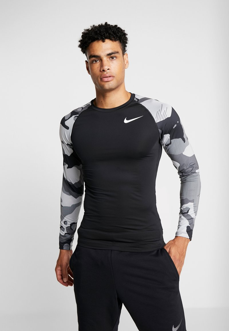 Nike Performance - SLIM CAMO  - Sports shirt - black/white