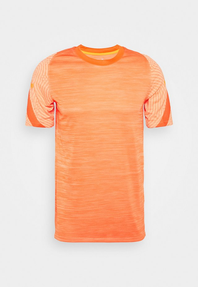 DRY STRIKE - Printtipaita - melon tint/total orange
