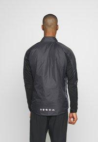 Nike Performance - Training jacket - black/white/silver - 2