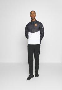 Nike Performance - Training jacket - black/white/silver - 1