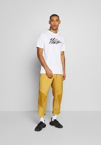 Nike Performance - DRY TEE PROJECT X - T-shirt con stampa - white - 1