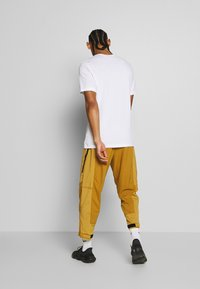 Nike Performance - DRY TEE PROJECT X - T-shirt con stampa - white - 2