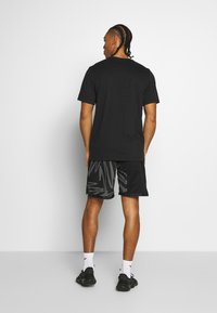 Nike Performance - DRY TEE PROJECT X - Camiseta estampada - black - 2