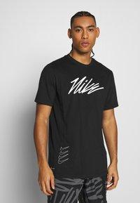 Nike Performance - DRY TEE PROJECT X - Camiseta estampada - black - 0