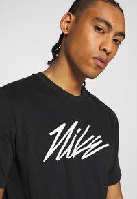 Nike Performance - DRY TEE PROJECT X - Camiseta estampada - black - 3