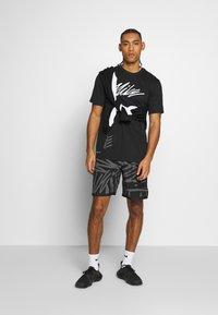 Nike Performance - DRY TEE PROJECT X - Camiseta estampada - black - 1