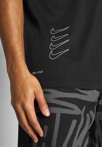 Nike Performance - DRY TEE PROJECT X - Camiseta estampada - black - 4