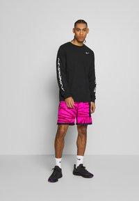 Nike Performance - DRY TEE TOKYO - Sports shirt - black - 1