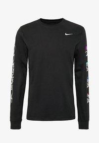 Nike Performance - DRY TEE TOKYO - Sports shirt - black - 5