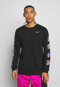 Nike Performance - DRY TEE TOKYO - Sports shirt - black - 0