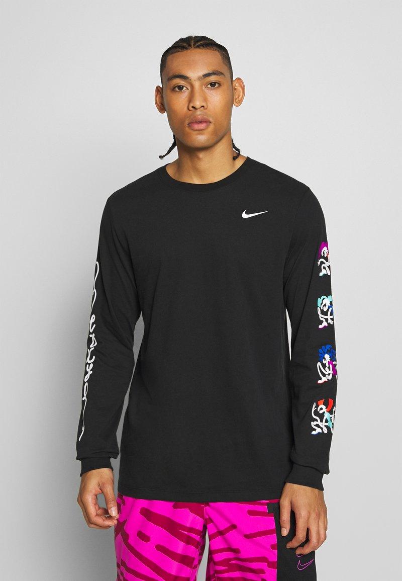 Nike Performance - DRY TEE TOKYO - Sports shirt - black