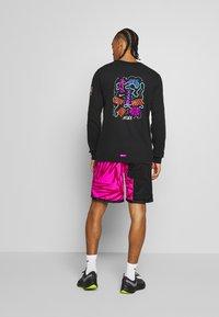 Nike Performance - DRY TEE TOKYO - Sports shirt - black - 2
