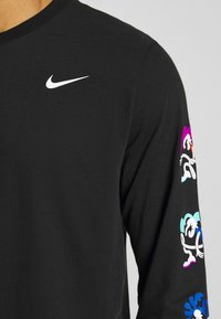 Nike Performance - DRY TEE TOKYO - Sports shirt - black - 6