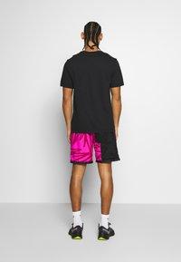 Nike Performance - DRY TEE TOKYO - T-shirt imprimé - black - 2