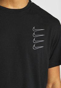 Nike Performance - Camiseta estampada - black/white - 6