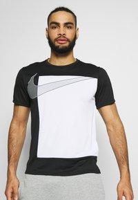 Nike Performance - SUPERSET  - Print T-shirt - black/white - 2