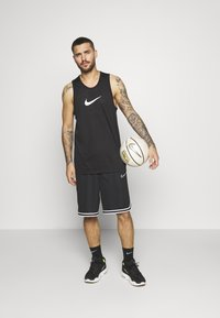 Nike Performance - DRY CROSSOVER - Sports shirt - black/white - 1