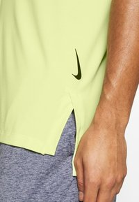 Nike Performance - DRY TANK YOGA - Camiseta de deporte - limelight/black - 5