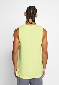 Nike Performance - DRY TANK YOGA - Camiseta de deporte - limelight/black - 2