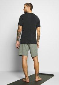 Nike Performance - DRY YOGA - Camiseta básica - black - 2