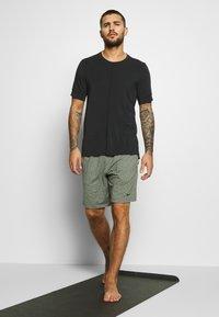 Nike Performance - DRY YOGA - Camiseta básica - black - 1