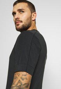 Nike Performance - DRY YOGA - Camiseta básica - black - 3