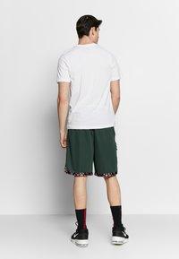 Nike Performance - DRY TEE CORE BBALL - Camiseta estampada - white - 2