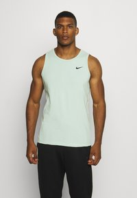 Nike Performance - DRY TANK SOLID - Sports shirt - pistachio frost - 0