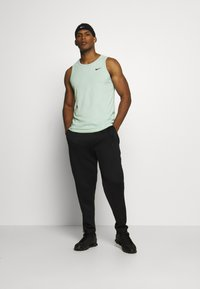 Nike Performance - DRY TANK SOLID - Sports shirt - pistachio frost - 1