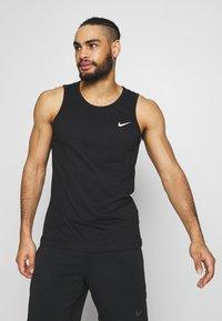 Nike Performance - DRY TANK SOLID - Tekninen urheilupaita - black /white - 0
