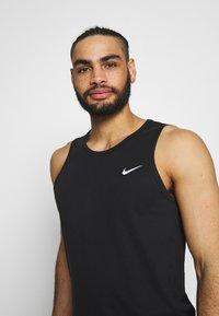 Nike Performance - DRY TANK SOLID - Sportshirt - black /white - 3