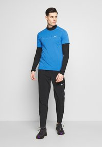 Nike Performance - DRY MILER - Print T-shirt - pacific blue - 1